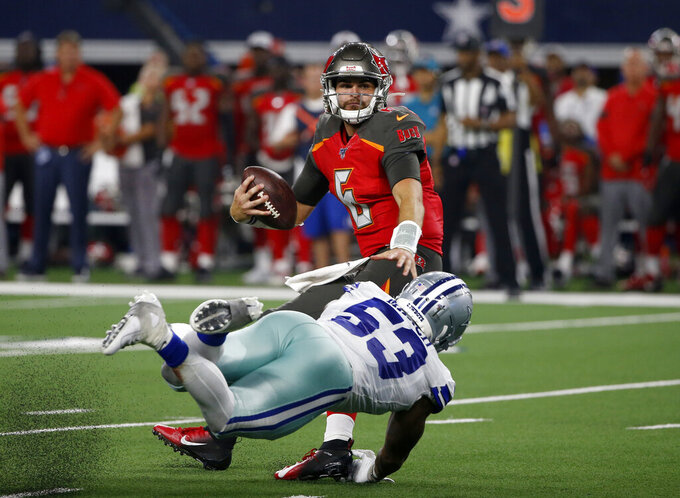 Tampa Bay Buccaneers quarterback Vincent Testaverde (6) is sacked by Dallas Cowboys linebacker Justin March-Lillard (53) in the second half of a preseason NFL football game in Arlington, Texas, Thursday, Aug. 29, 2019. (AP Photo/Ron Jenkins)