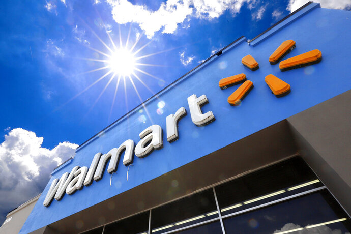 FILE - This June 25, 2019, file photo shows the entrance to a Walmart in Pittsburgh. A lawsuit filed earlier this week by Walmart over fires in rooftop solar panels made by Tesla Inc. has been sealed by the court, and both sides say they look forward to addressing all issues. In joint statements Friday, Aug. 23, the companies say they look forward to re-activating the panels once both sides are certain that all concerns have been addressed.(AP Photo/Gene J. Puskar, File)
