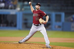 Arizona Diamondbacks starting pitcher Merrill Kelly (29) throws during the first inning of a baseball game against the Los Angeles Dodgers Wednesday, Sept. 15, 2021, in Los Angeles. (AP Photo/Ashley Landis)