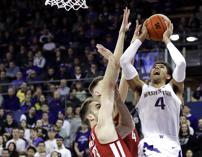 Washington guard Matisse Thybulle (4) shoots against Washington State forwards Jeff Pollard, left, and Aljaz Kunc, second from left, during the first half of an NCAA college basketball game, Saturday, Jan. 5, 2019, in Seattle. (AP Photo/Ted S. Warren)