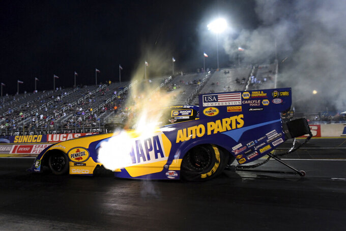 In this photo provided by the NHRA, Ron Capps drives in Funny Car qualifying  Friday, Sept. 4, 2020, at the NHRA U.S. Nationals drag races in Brownsburg, Ind. (Marc Gewertz/NHRA via AP)