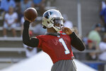 Carolina Panthers quarterback Cam Newton looks to pass during practice at the NFL football team's training camp in Spartanburg, N.C., Thursday, July 25, 2019. (AP Photo/Chuck Burton)