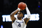 Xavier's Tyrique Jones takes a foul shot in the second half of the team's NCAA college basketball game against Jacksonville, Tuesday, Nov. 5, 2019, in Cincinnati. (AP Photo/John Minchillo)