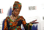 FILE - In this Thursday, April 21, 2016 file photo, singer and UNICEF Goodwill Ambassador Angelique Kidjo poses at the opening of the new photography exhibit
