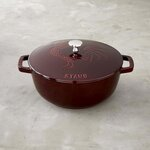 This photo provided by Williams-Sonoma shows Staub's Rooster French Oven. Staub offers a range of cast iron cookware, including the Rooster French Oven which combines the depth of a sauté pan with the curved sides of a skillet. An embossed rooster adds design flair to the lid, and the oven is available in enameled grenadine or sapphire blue hues. (Williams-Sonoma via AP)