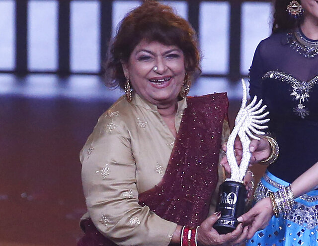 FILE - In this Sept. 19, 2019, file photo, Indian choreographer Saroj Khan is presented a special award during the 20th International Indian Film Academy (IIFA) awards ceremony in Mumbai, India.  Saroj Khan, a top Bollywood choreographer, died of cardiac arrest in a Mumbai hospital early Friday, July 3, 2020, her family said. She was 71. (AP Photo/Rafiq Maqbool, File)