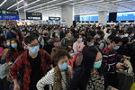 Passengers wear protective face masks at the departure hall of the high speed train station in Hong Kong, Thursday, Jan. 23, 2020. China closed off a city of more than 11 million people Thursday, halting transportation and warning against public gatherings, to try to stop the spread of a deadly new virus that has sickened hundreds and spread to other cities and countries in the Lunar New Year travel rush. (AP Photo/Kin Cheung)