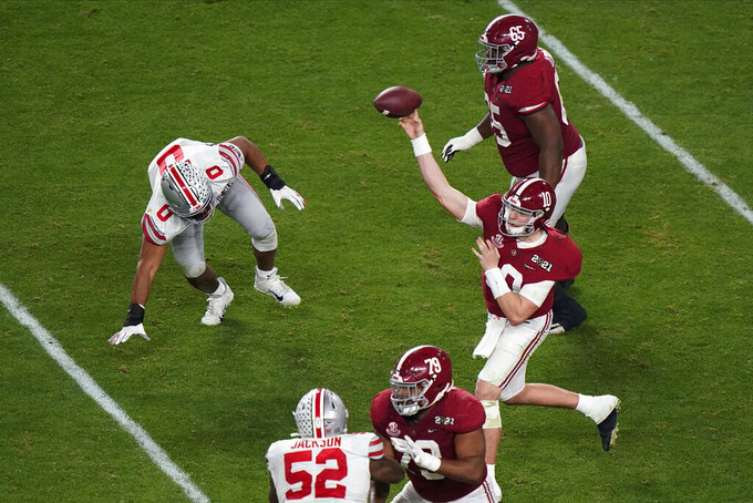Alabama quarterback Mac Jones passes against Ohio State during the first half of an NCAA College Football Playoff national championship game, Monday, Jan. 11, 2021, in Miami Gardens, Fla. (AP Photo/Wilfredo Lee)