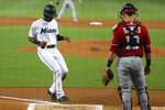 Miami Marlins' Magneuris Sierra (34) scores on a sacrifice fly by Starlin Castro as Washington Nationals catcher Yan Gomes (10) waits for the throw during the first inning of a baseball game, Sunday, Sept. 22, 2019, in Miami. (AP Photo/Wilfredo Lee)