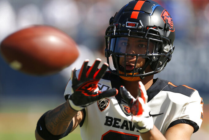 """FILE - Oregon State defensive back Jaydon Grant (3) is shown in the second half during an NCAA college football game against Arizona, Saturday, Nov. 2, 2019, in Tucson, Ariz. This summer college athletes have called out coaches and administrators, thrown widespread public support behind causes both social (Black Lives Matter) and political (changing the Mississippi state flag) and demanded to be part of the discussions about whether sports can be played safely during a pandemic. """"We all know that this isn't a movement for the present,"""" said Oregon State defensive back Jaydon Grant, who one of the leaders of the Pac-12 We Are United group.  (AP Photo/Rick Scuteri, File)"""