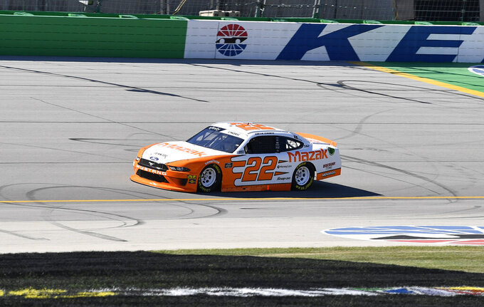 Austin Cindric (22) crosses the finish line to take the pole for an Xfinity Series auto race at Kentucky Speedway in Sparta, Ky., Friday, July 12, 2019. (AP Photo/Timothy D. Easley)