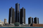 This May 12, 2020, photo shows a general view of the Renaissance Center, headquarters for General Motors, along the Detroit skyline from the Detroit River. A federal judge in Detroit dismissed General Motors' lawsuit Wednesday, July 8, 2020, alleging that rival Fiat Chrysler paid off union leaders to get better contract terms than GM. (AP Photo/Paul Sancya)
