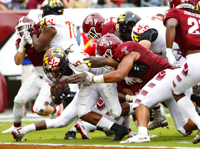 Maryland running back Anthony McFarland Jr. (5) breaks through the line to score a touchdown during the second half of an NCAA college football against Temple, Saturday, Sept. 14, 2019, in Philadelphia. Temple won 20-17. (AP Photo/Chris Szagola)