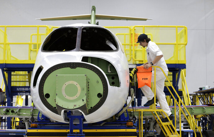 This July 30, 2019 shows a HondaJet Elite aircraft in production at the Honda Aircraft Co. headquarters in Greensboro, N.C. Nearly four years after delivering its first jet, Honda is facing decisions as the company better known for cars and lawnmowers considers whether to sink billions more into its decades-in-the-making aircraft division. (AP Photo/Gerry Broome)