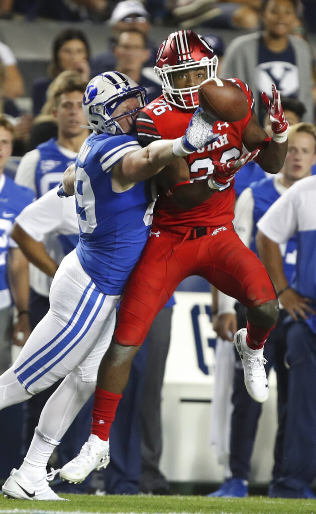 BYU tight end Matt Bushman (89) breaks up a potential interception by Utah defensive back Terrell Burgess (26) in the second half during an NCAA college football game, Thursday, Aug. 29, 2019, in Provo, Utah. (AP Photo/George Frey)