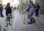 Harvey Weinstein's lead attorney Donna Rotunno, left, holds his walker at the bottom of a staircase as he leaves court for the day during jury selection in his trial on rape and sexual assault charges, Wednesday, Jan. 15, 2020, in New York. Jury selection continues Thursday. (AP Photo/Mary Altaffer)