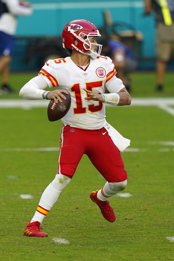 Kansas City Chiefs quarterback Patrick Mahomes (15) looks to pass the football, during the first half of an NFL football game against the Miami Dolphins, Sunday, Dec. 13, 2020, in Miami Gardens, Fla. (AP Photo/Lynne Sladky)