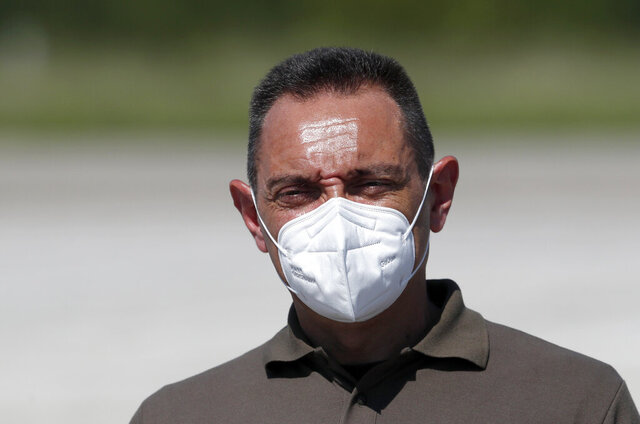 In this photo taken Friday, Aug. 21, 2020, Serbia Defense Minister Aleksandar Vulin wearing a mask to protect against coronavirus speaks after the military exercises on Batajnica, military airport near Belgrade, Serbia. Vulin said Wednesday Sept. 9, 2020, the government decided to suspend all war games