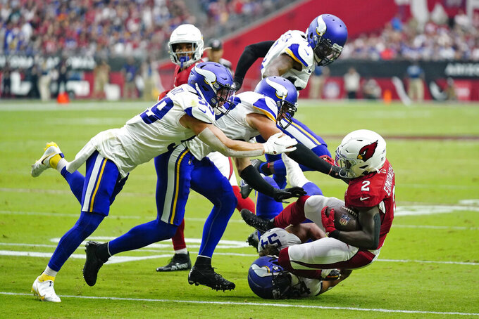 Arizona Cardinals running back Chase Edmonds (2) is hit by Minnesota Vikings middle linebacker Eric Kendricks (54) during the first half of an NFL football game, Sunday, Sept. 19, 2021, in Glendale, Ariz. (AP Photo/Ross D. Franklin)
