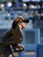 Arizona Diamondbacks starting pitcher Zack Greinke throws to the plate during the first inning of a baseball game against the Los Angeles Dodgers Thursday, March 28, 2019, in Los Angeles. (AP Photo/Mark J. Terrill)