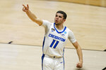 Creighton guard Marcus Zegarowski (11) celebrates a three-point basket against Ohio in the first half of a second-round game in the NCAA men's college basketball tournament at Hinkle Fieldhouse in Indianapolis, Monday, March 22, 2021. (AP Photo/Michael Conroy)