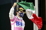 Racing Point driver Sergio Perez of Mexico celebrates his victory in the Formula One Bahrain Grand Prix in Sakhir, Bahrain, Sunday, Dec. 6, 2020. (Tolga Bozoglu, Pool via AP)