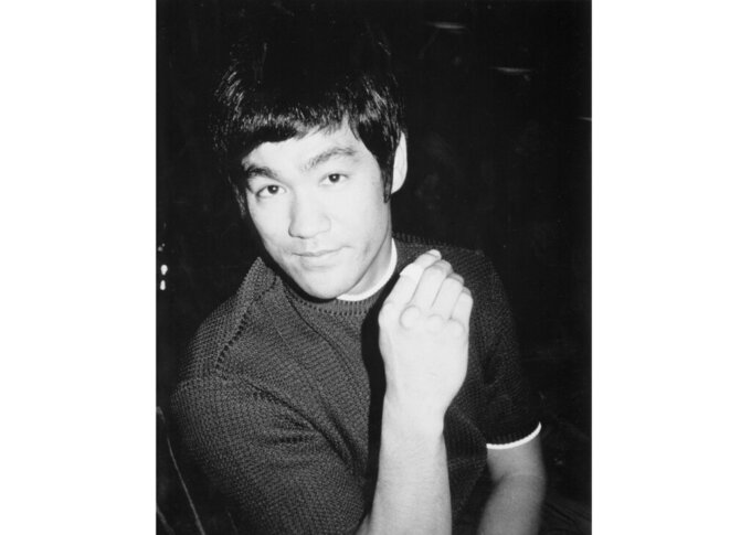 """This image released by ESPN Films shows Bruce Lee, the subject of the the documentary """"Be Water."""" The film, which details the movie star's tragically short career, captures the cool power of Lee, an early Asian American big-screen hero. It airs Sunday at 9 p.m. EDT on ESPN as part of the network's """"30 for 30"""" documentary series. (Bruce Lee Family Archive/ESPN Films via AP)"""
