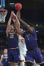 Lipscomb forward Eli Pepper (22) and center Ahsan Asadullah (2) vie for a rebound against Texas forward Gerald Liddell (0) during the first half of an NCAA college basketball game for the NIT championship Thursday, April 4, 2019, at Madison Square Garden in New York. (AP Photo/Mary Altaffer)