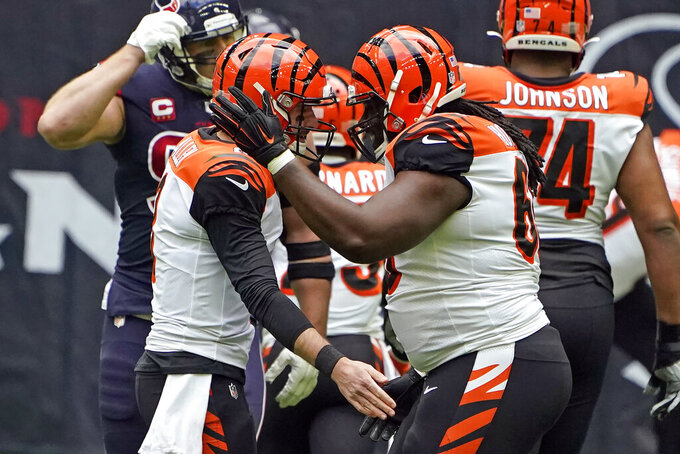 Cincinnati Bengals quarterback Brandon Allen, left, celebrates with center Trey Hopkins after throwing a touchdown pass against the Houston Texans during the first half of an NFL football game Sunday, Dec. 27, 2020, in Houston. (AP Photo/Eric Christian Smith)