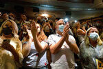 """The audience applauds as """"Hamilton!"""" creator Lin-Manuel Miranda gives a curtain speech at the Richard Rodgers Theatre, in New York, as the show opened Tuesday, Sept. 14, 2021, after being closed in early 2020 due to COVID-19 concerns. (AP Photo/Craig Ruttle)"""