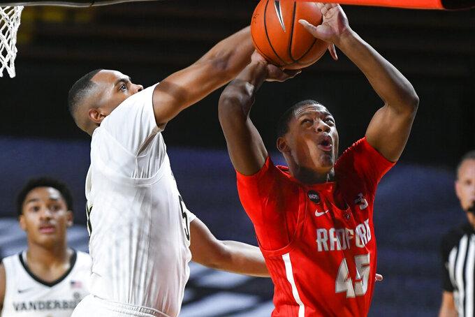 Radford guard Xavier Lipscomb (45) is fouled by Vanderbilt guard D.J. Harvey during the first half of an NCAA college basketball game Saturday, Dec. 19, 2020, in Nashville, Tenn. Vanderbilt won 59-50. (AP Photo/John Amis)