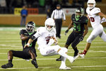 North Texas defensive back Kemon Hall (16) takes down Florida Atlantic quarterback Chris Robison (5) during the first half of an NCAA college football game Thursday, Nov. 15, 2018, in Denton, Texas. (Jake King/The Denton Record-Chronicle via AP)