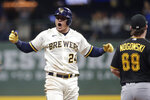 Milwaukee Brewers' Avisail Garcia (24) yells to the dugout after hitting an RBI-double during the seventh inning of a baseball game against the Pittsburgh Pirates, Tuesday, Aug. 3, 2021, in Milwaukee. (AP Photo/Aaron Gash)
