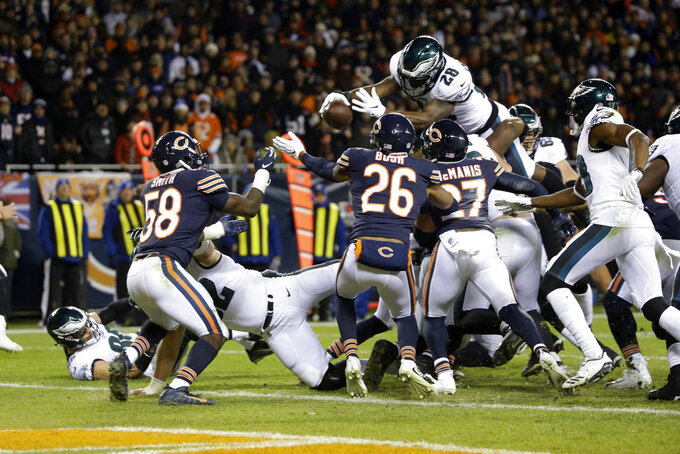 Philadelphia Eagles running back Wendell Smallwood (28) unsuccessfully dives for a two-point conversion during the second half of an NFL wild-card playoff football game against the Chicago Bears Sunday, Jan. 6, 2019, in Chicago. The Eagles won 16-15. (AP Photo/David Banks)