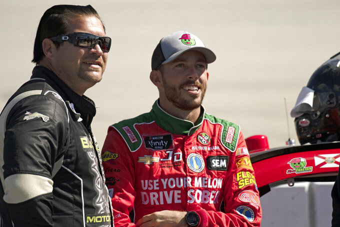 Drivers B.J. McLeod, left, and Ross Chastain wait to get into their cars before qualifying for the  NASCAR Xfinity Series auto race, Saturday, Oct. 5, 2019, in Dover, Del. (AP Photo/Brien Aho)
