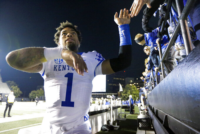 Kentucky's Lynn Bowden Jr. celebrates with fans after an NCAA college football game against Vanderbilt, Saturday, Nov. 16, 2019, in Nashville, Tenn. (AP Photo/Mark Humphrey)