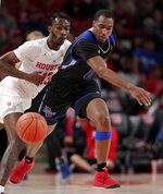 Houston guard Dejon Jarreau (13) and Tulsa guard Chris Barnes (0) chase a loose ball down court during the first half of an NCAA college basketball game Wednesday, Jan. 2, 2019, in Houston. (AP Photo/Michael Wyke)