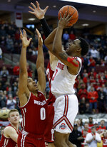 Ohio State guard C.J. Jackson, right, goes up for a shot against Wisconsin guard D'Mitrik Trice during the second half of an NCAA college basketball game in Columbus, Ohio, Sunday, March 10, 2019. Wisconsin won 73-67 in overtime. (AP Photo/Paul Vernon)