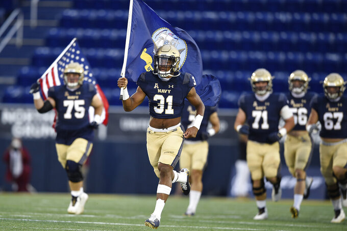 Navy's Austin Talbert-Loving leads the team onto the field for an NCAA college football game against Temple on Saturday, Oct. 10, 2020, in Annapolis, Md. (AP Photo/Gail Burton)
