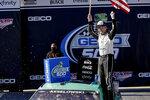 Brad Keselowski (2) celebrates after winning the Geico 500 NASCAR Sprint Cup auto race at Talladega Superspeedway, Sunday, April 25, 2021, in Talladega, Ala. (AP Photo/Butch Dill)
