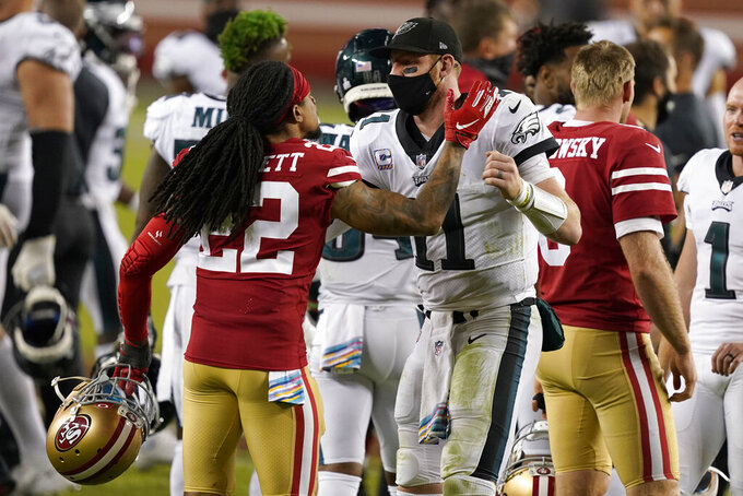 Philadelphia Eagles quarterback Carson Wentz, right, greets San Francisco 49ers cornerback Jason Verrett after the Eagles defeated the 49ers in an NFL football game in Santa Clara, Calif., Sunday, Oct. 4, 2020. (AP Photo/Tony Avelar)