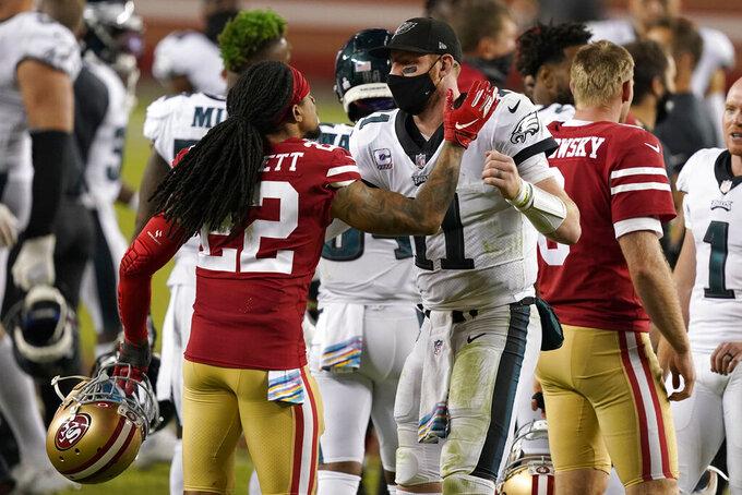 Philadelphia Eagles quarterback Carson Wentz, right, greets San Francisco 49ers cornerback Jason Verrett after the Eagles defeated the 49ers in an NFL football game in Santa Clara, Calif., Sunday, Oct. 4, 2020. (AP Photo/Tony Avelar)