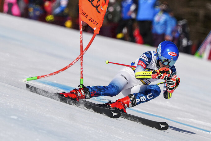 United States' Mikaela Shiffrin speeds down the course during a women's giant slalom, at the alpine ski World Championships, in Cortina d'Ampezzo, Italy, Thursday, Feb. 18, 2021. (AP Photo/Giovanni Auletta)