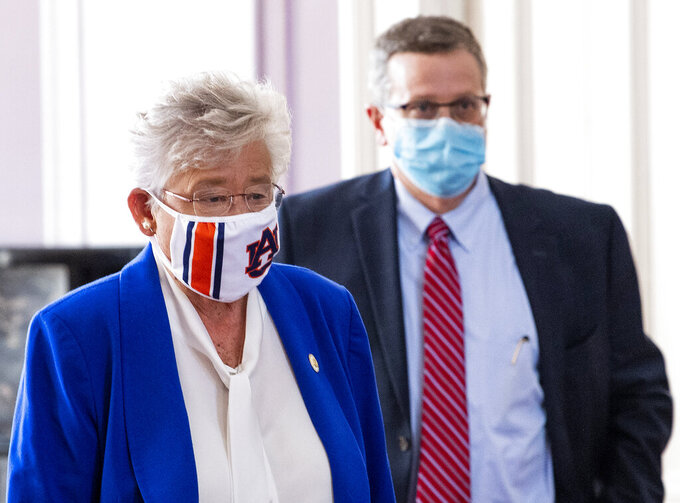 Alabama Gov. Kay Ivey and State Health Officer Dr. Scott Harris arrive to announce a statewide mask order during a news conference in the state capitol building in Montgomery, Ala., on Wednesday, July 15, 2020. (Mickey Welsh/The Montgomery Advertiser via AP)