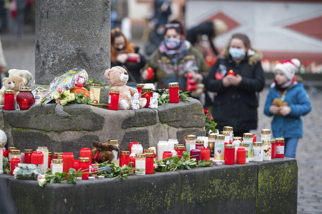 At several places in the pedestrian zone people have put up candles in memory of the victims in Trier Germany, Wednesday, Dec.2, 2020. The day before, a 51-year-old man had raced through the pedestrian zone in an SUV, killing five people in the process. (Oliver Dietze/dpa via AP)