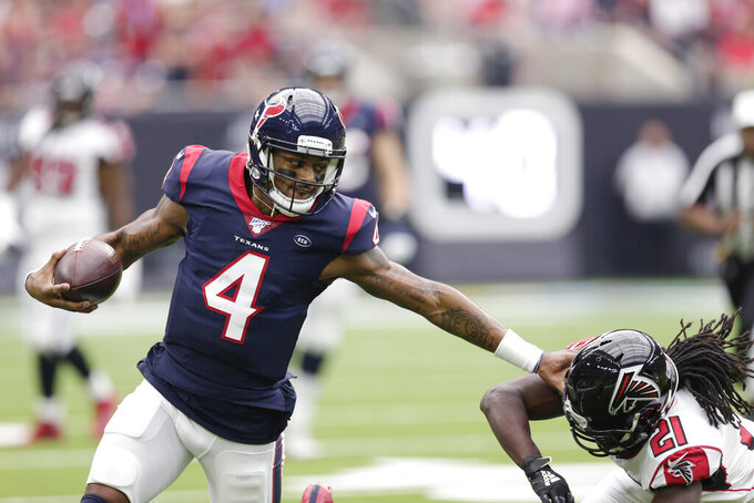 Houston Texans quarterback Deshaun Watson (4) runs around Atlanta Falcons cornerback Desmond Trufant (21) during the first half of an NFL football game Sunday, Oct. 6, 2019, in Houston. (AP Photo/Michael Wyke)