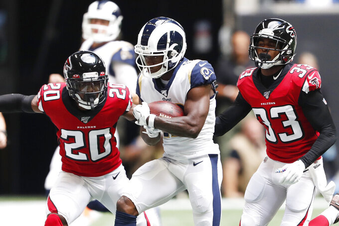 Los Angeles Rams wide receiver Brandin Cooks (12) runs after a catch against Atlanta Falcons defensive back Kendall Sheffield (20) during the first half of an NFL football game, Sunday, Oct. 20, 2019, in Atlanta. (AP Photo/John Bazemore)