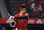 Los Angeles Angels' Shohei Ohtani, of Japan, loses his helmet as he strikes out during the sixth inning of the team's baseball game against the Texas Rangers on Wednesday, Aug. 28, 2019, in Anaheim, Calif. (AP Photo/Mark J. Terrill)