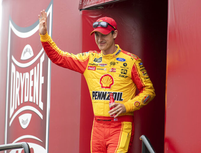 Joey Logano (22) walks on to the stage during driver introductions at the Drydene 400 - Monster Energy NASCAR Cup Series playoff auto race, Sunday, Oct. 6, 2019, at Dover International Speedway in Dover, Del. (AP Photo/Jason Minto)