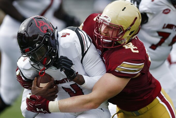 Boston College defensive lineman Tanner Karafa sacks Louisville quarterback Jawon Pass (4) during the first half of an NCAA college football game in Boston, Saturday, Oct. 13, 2018. (AP Photo/Michael Dwyer)
